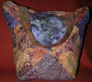faeriebuzz - fiber and glass: an eclectic blend of handmade clothing (skirts, pants, tops, dresses), quilts, wallhang\ ings, pens, pendants, and jars :  hippie chick patchwork tote purple